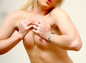 Blonde Transexual Playing With Cock