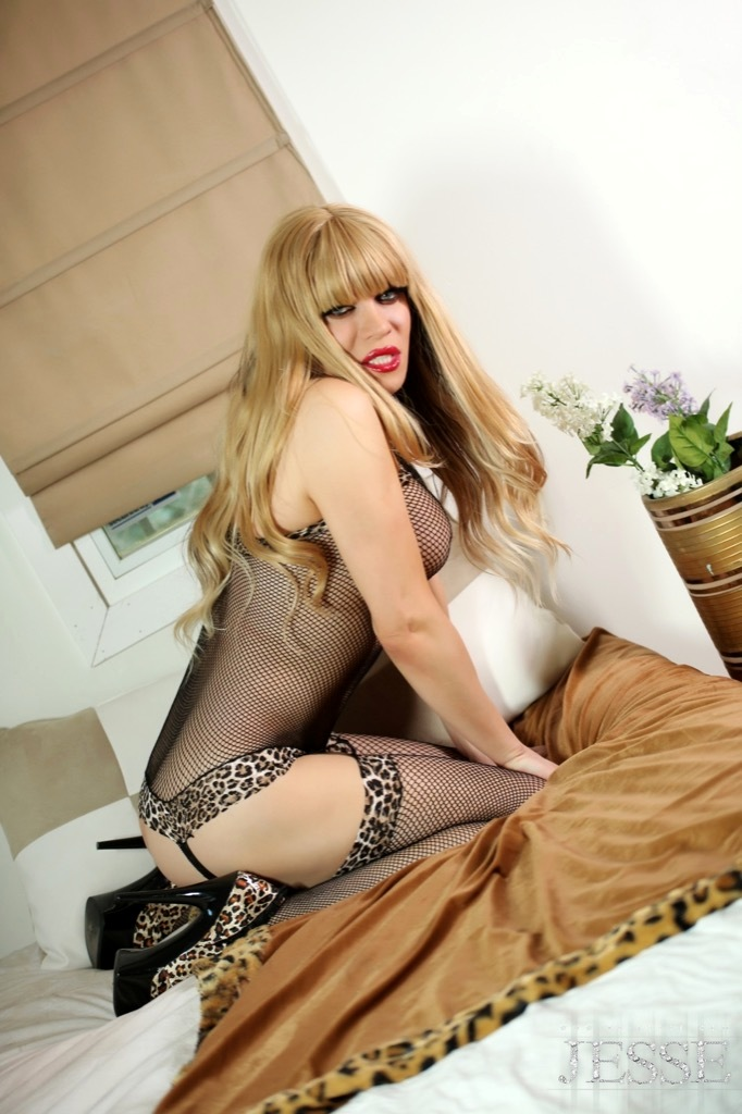 Jesse Is Having Fun With Her Inviting Fishnets And Playing With Her Massive Dick