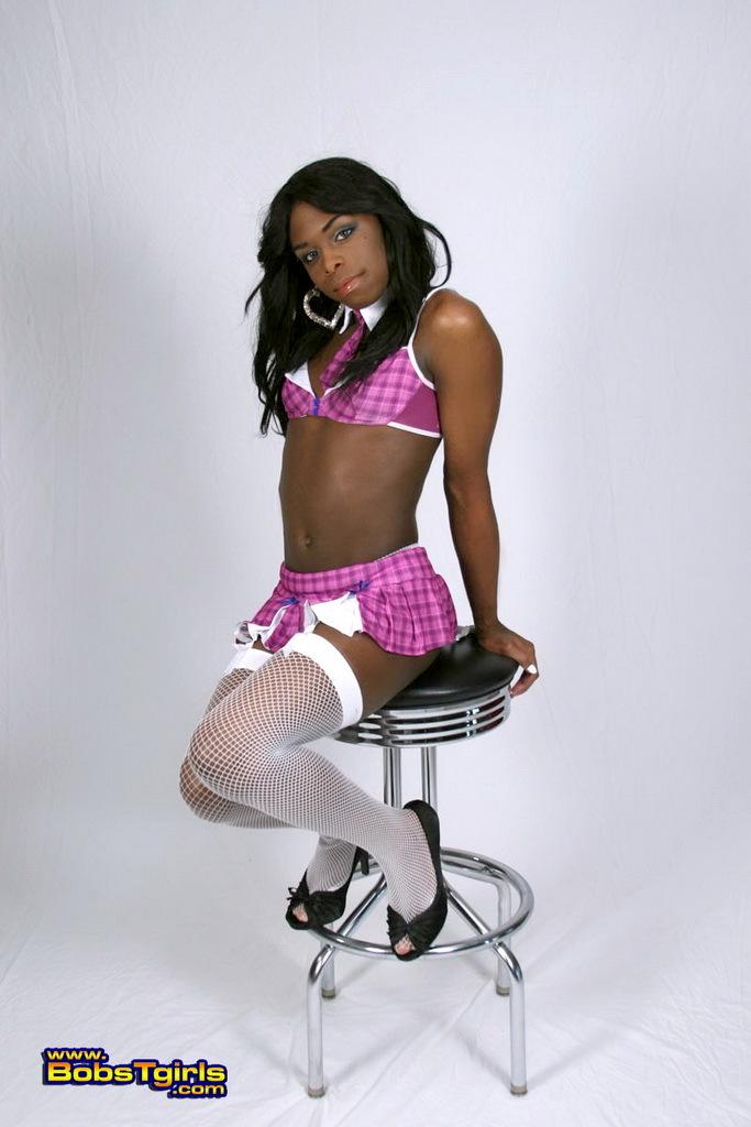 Ebony T-Girl Eclair Posing As A Slutty Schoolgirl
