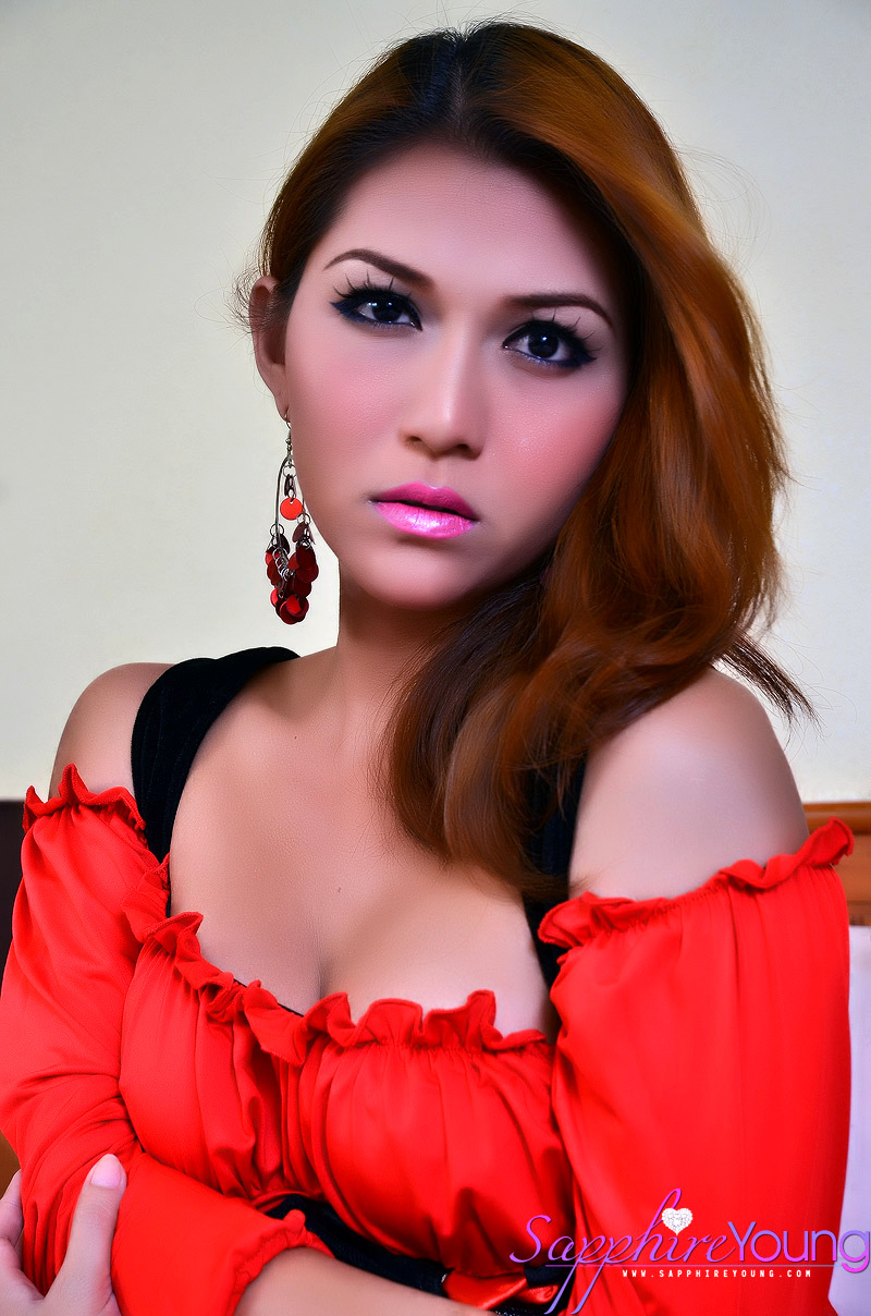 Red Arousing Oriental Ladyboy Sapphire Young Jizzes On Her