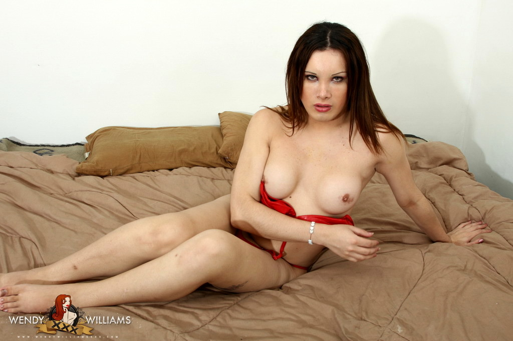 Seductive Alejandra Strips And Spreads In Red Outfit