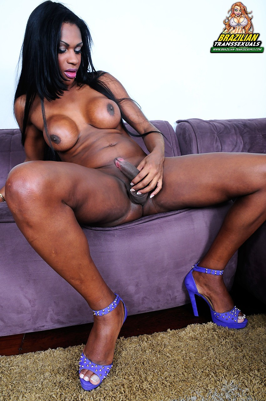 Back Transsexual Posing On Sofa